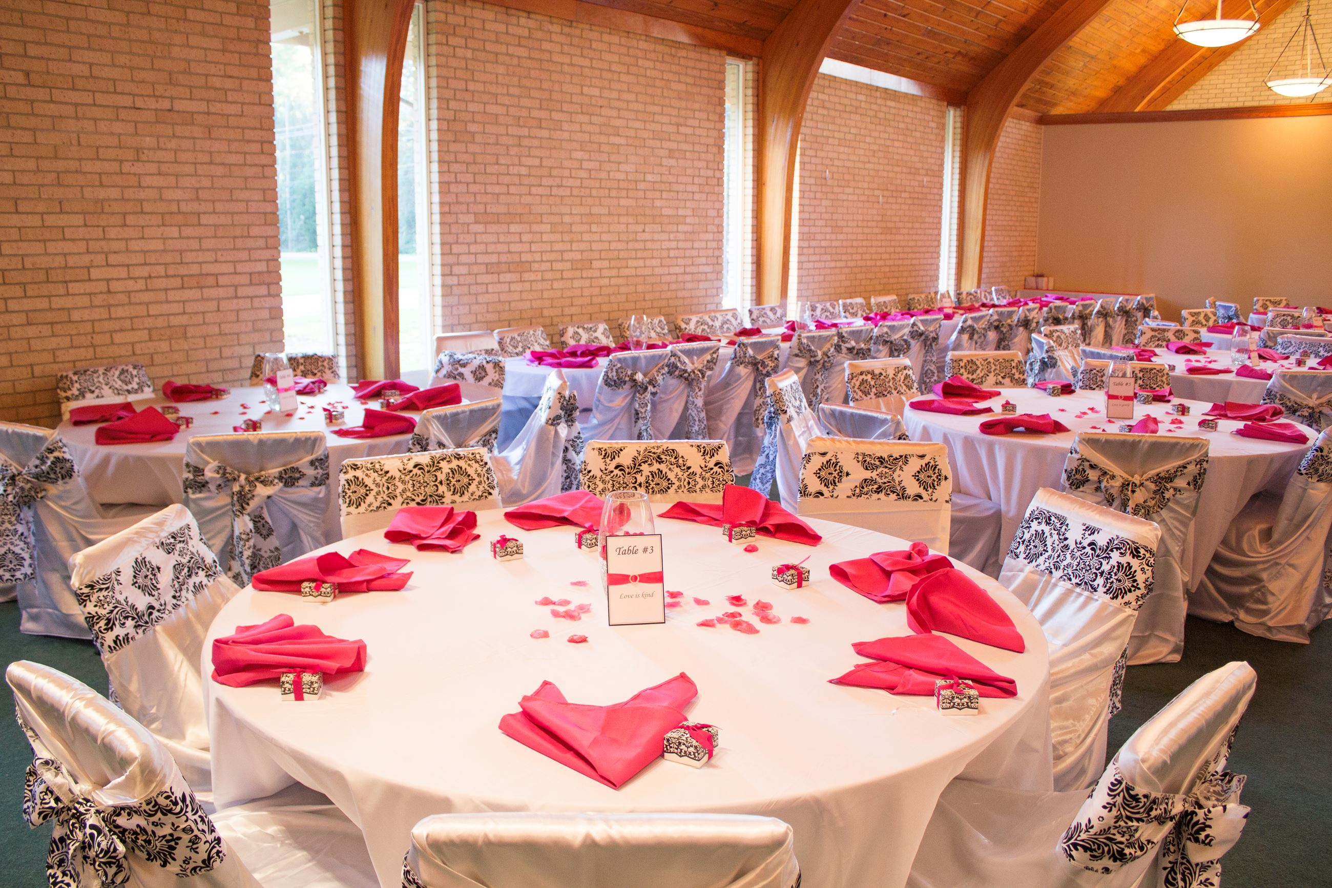 An image of a church sanctuary decorated for wedding reception