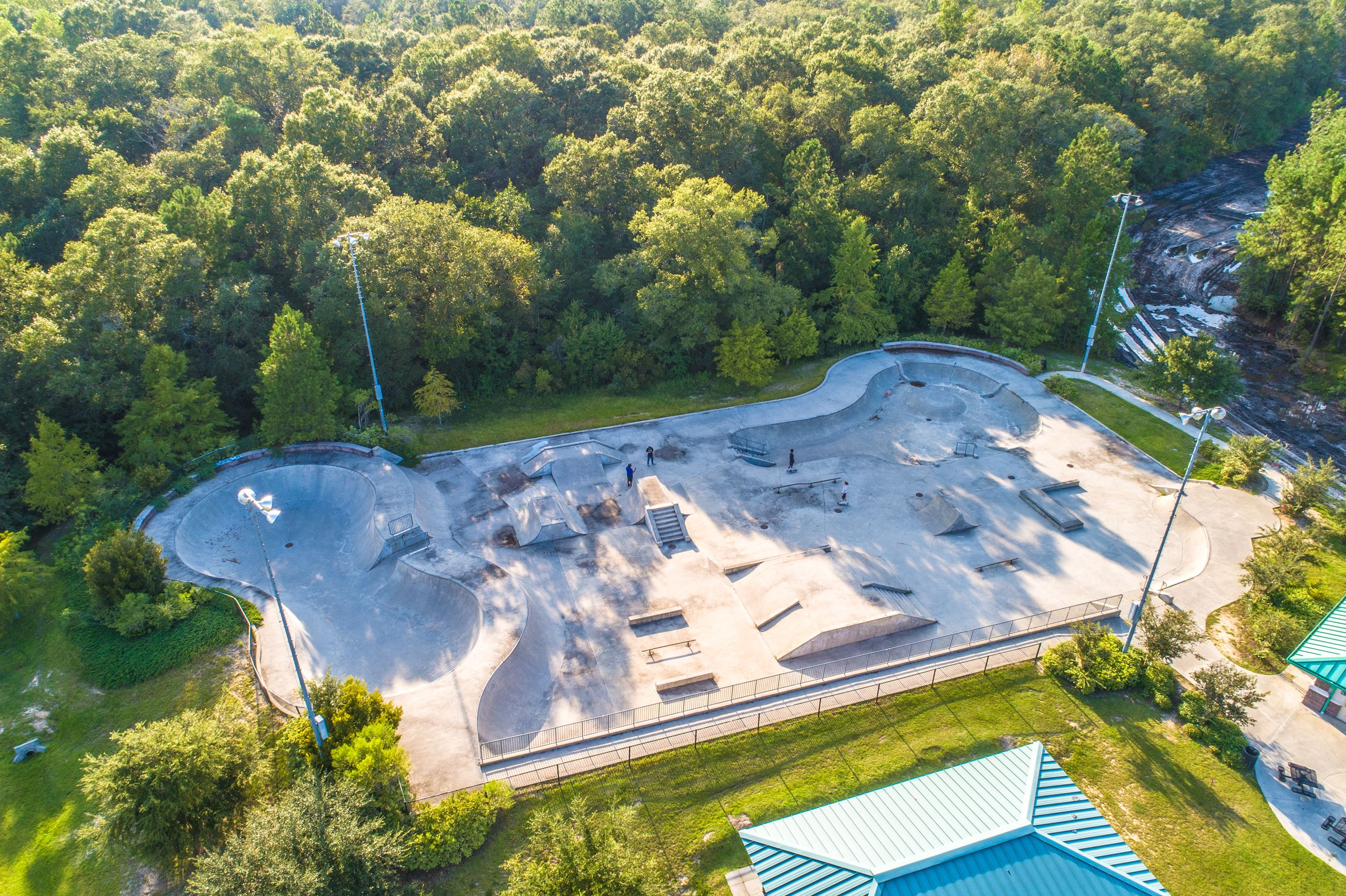 An image of an aerial view of a concrete skate park.