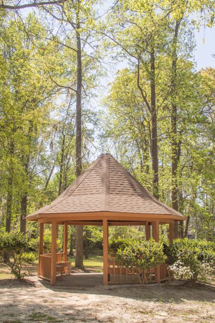 Image of a wooden gazebo in a park.