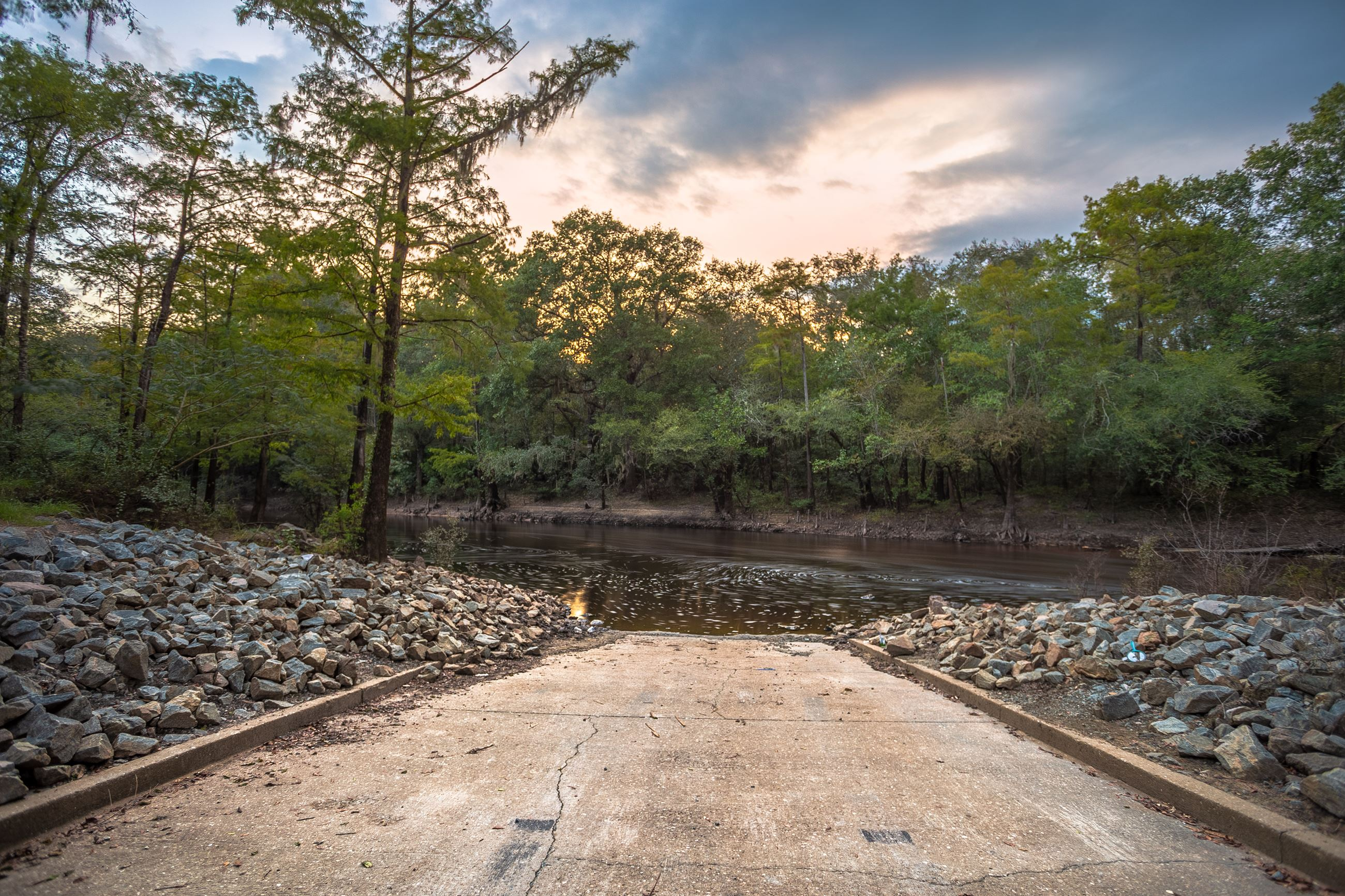 Image of a boat ramp into a river.