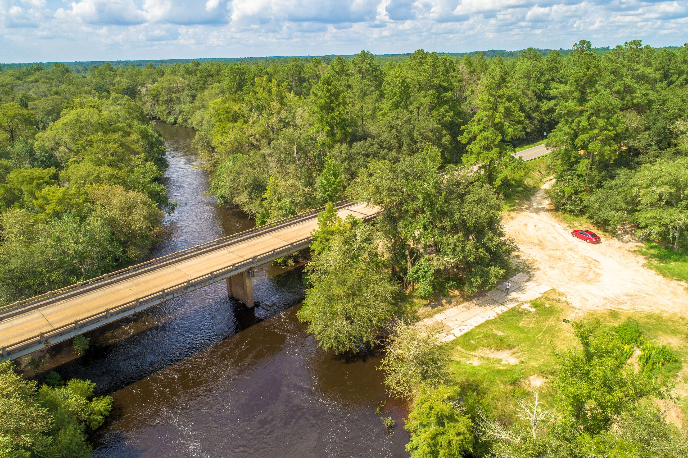 Image of an aerial view of a boat ramp into a river.