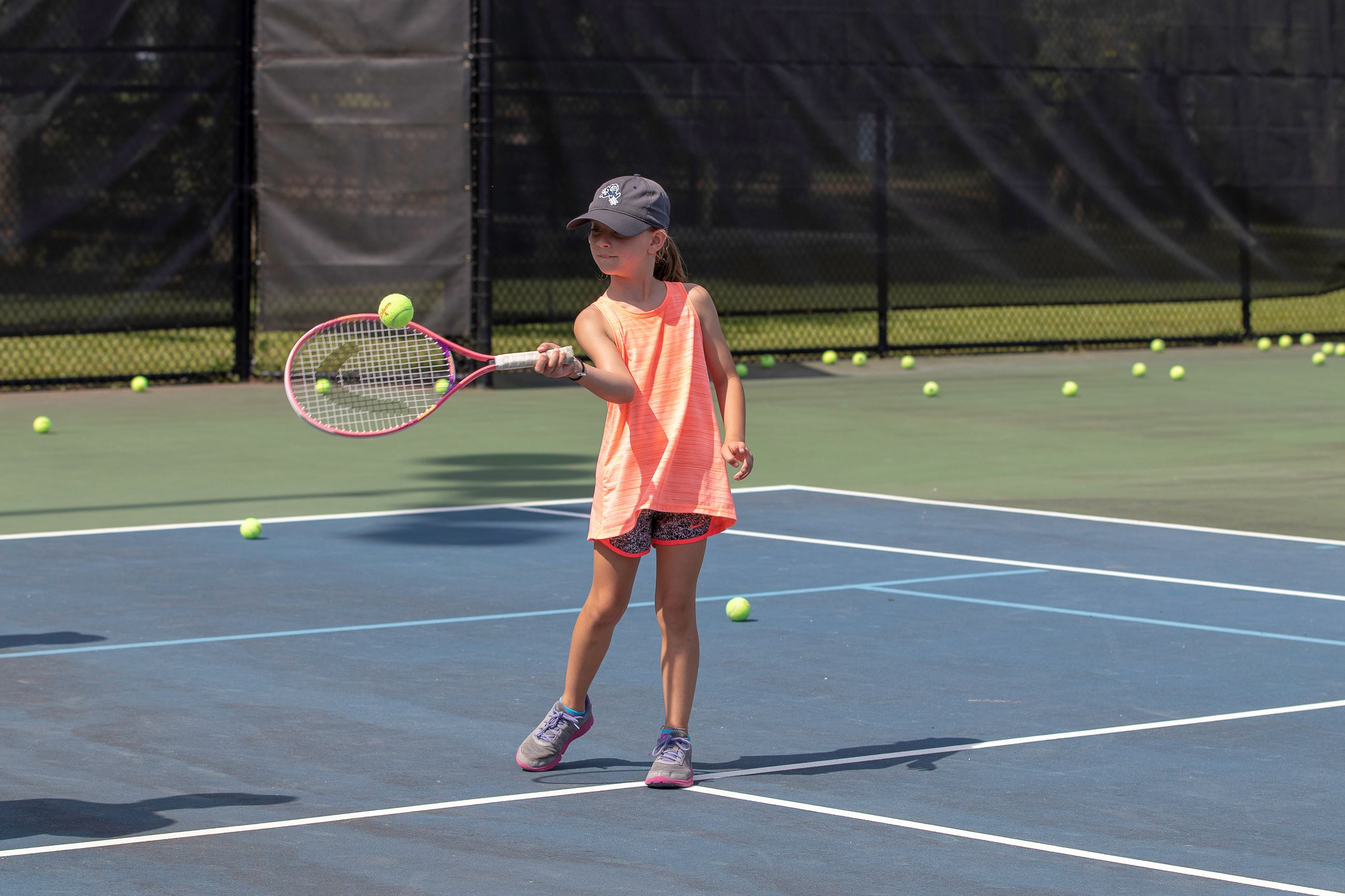 Image of child playing tennis.