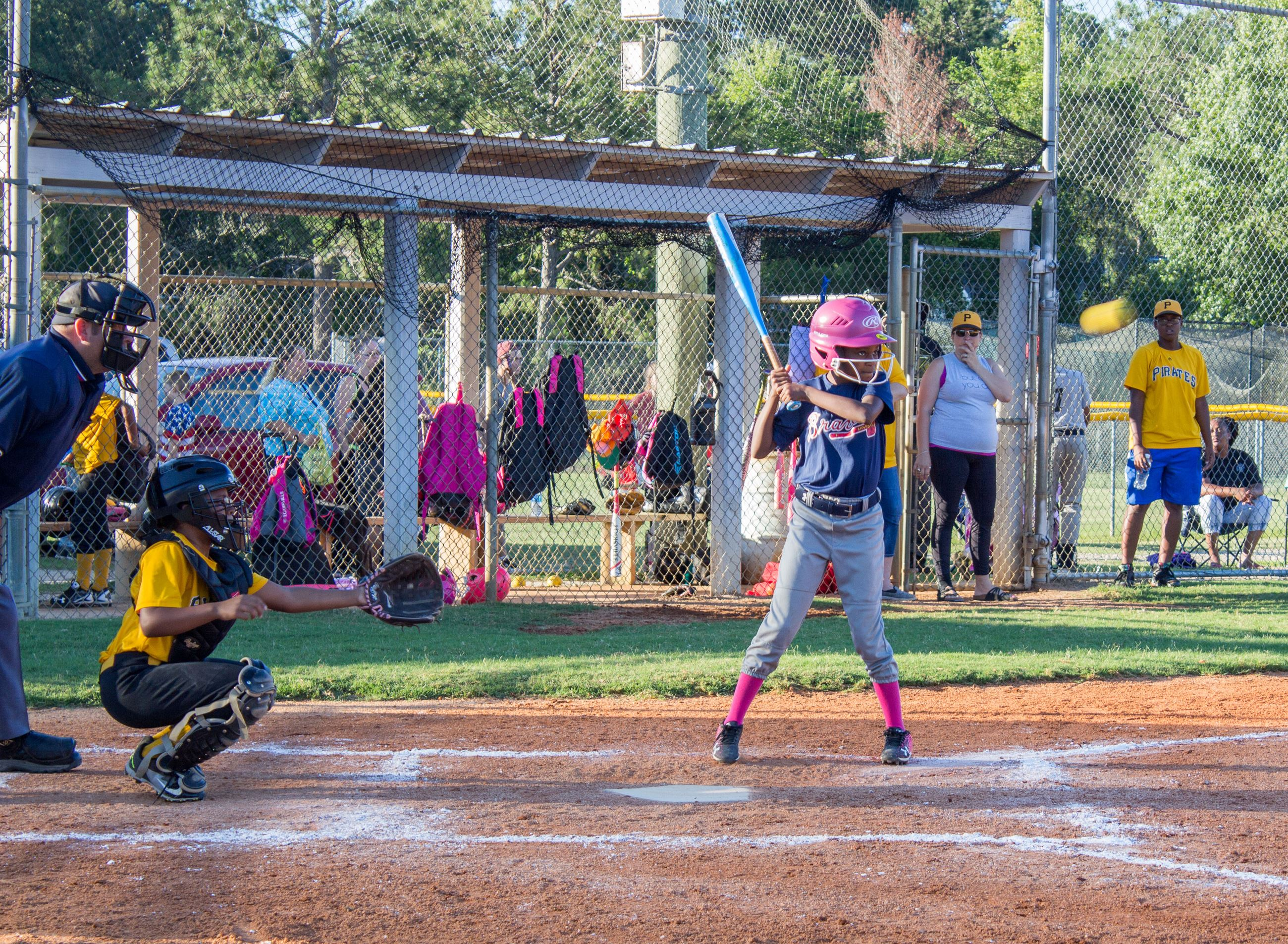Image of girl playing softball.