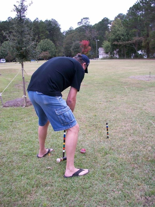 Man plays croquet