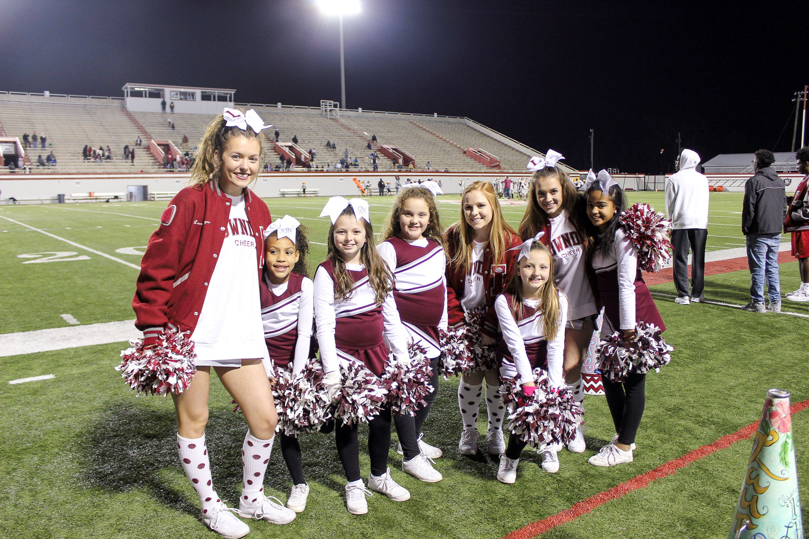 Image of cheerleaders posing for picture.