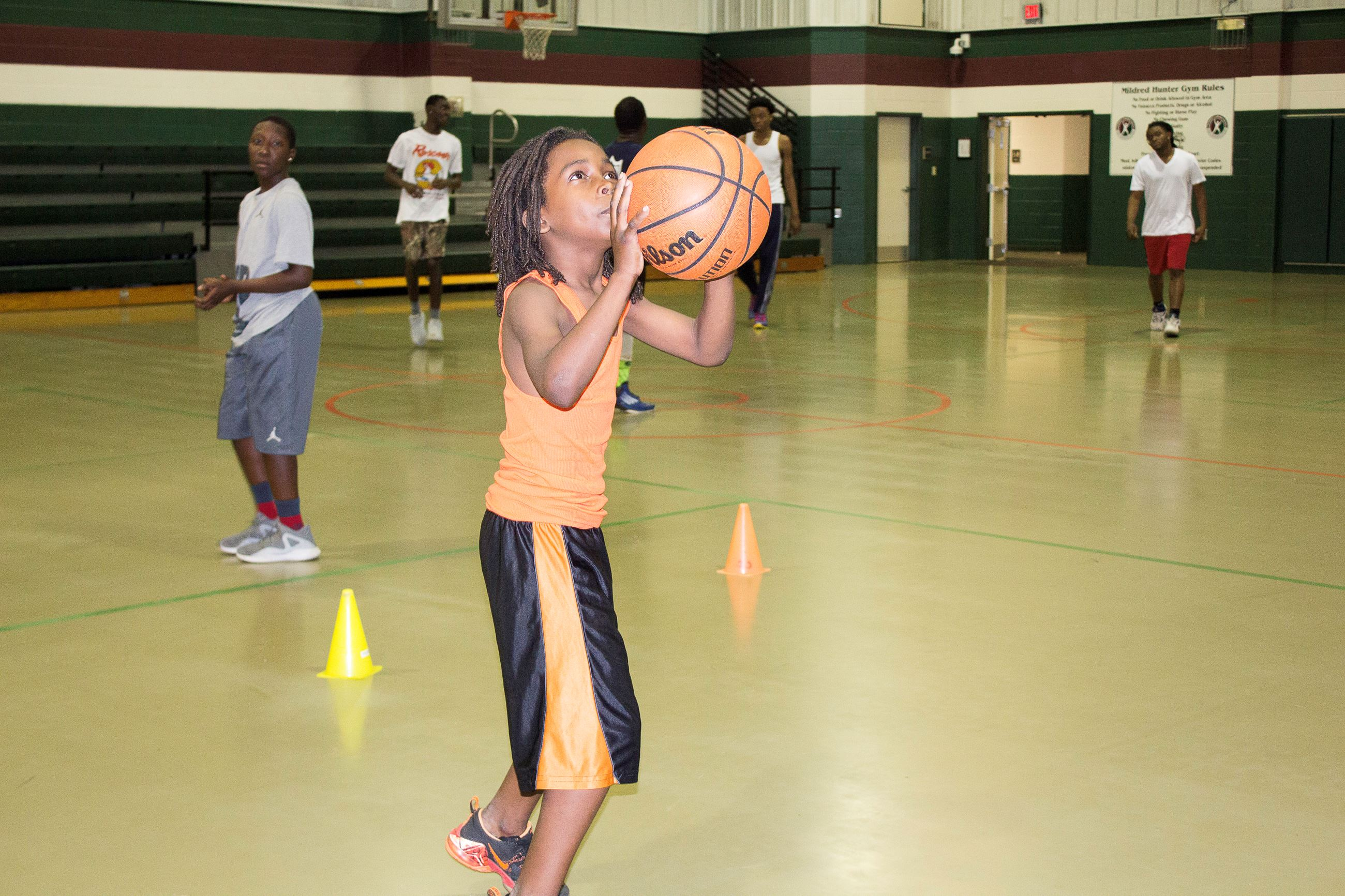 Image of child playing basketball.