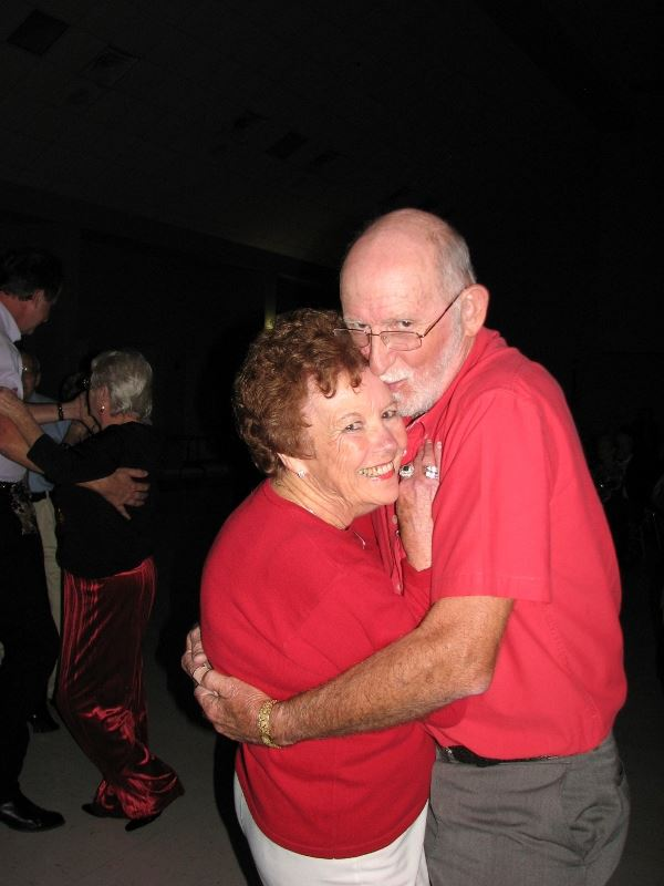 Man and woman hug at event