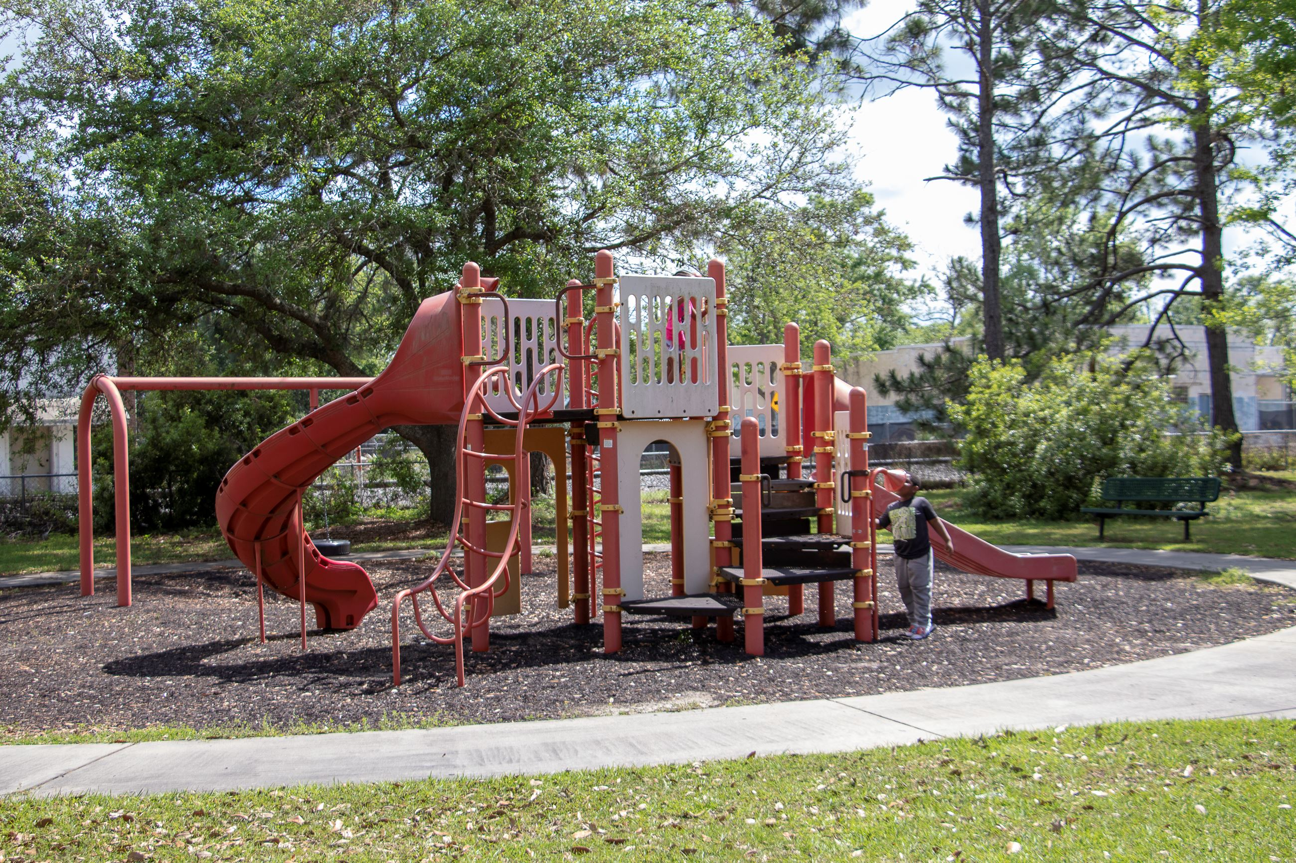 Image of children playing on a playground.