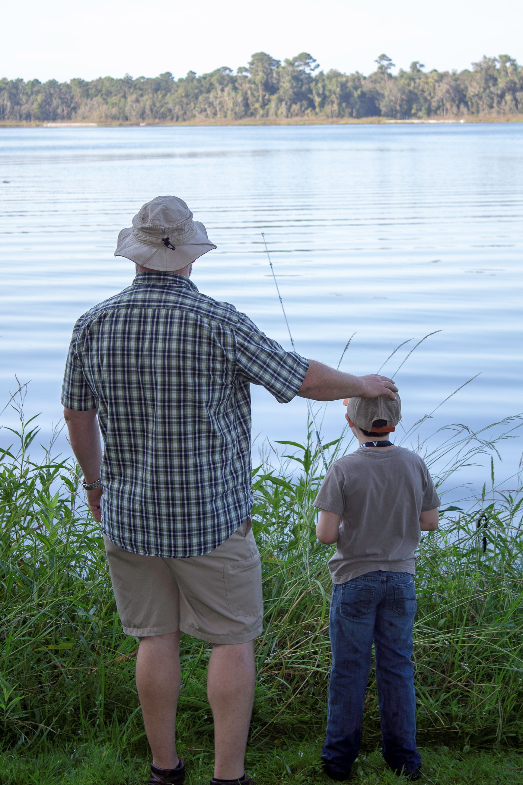 Image of adult and child fishing