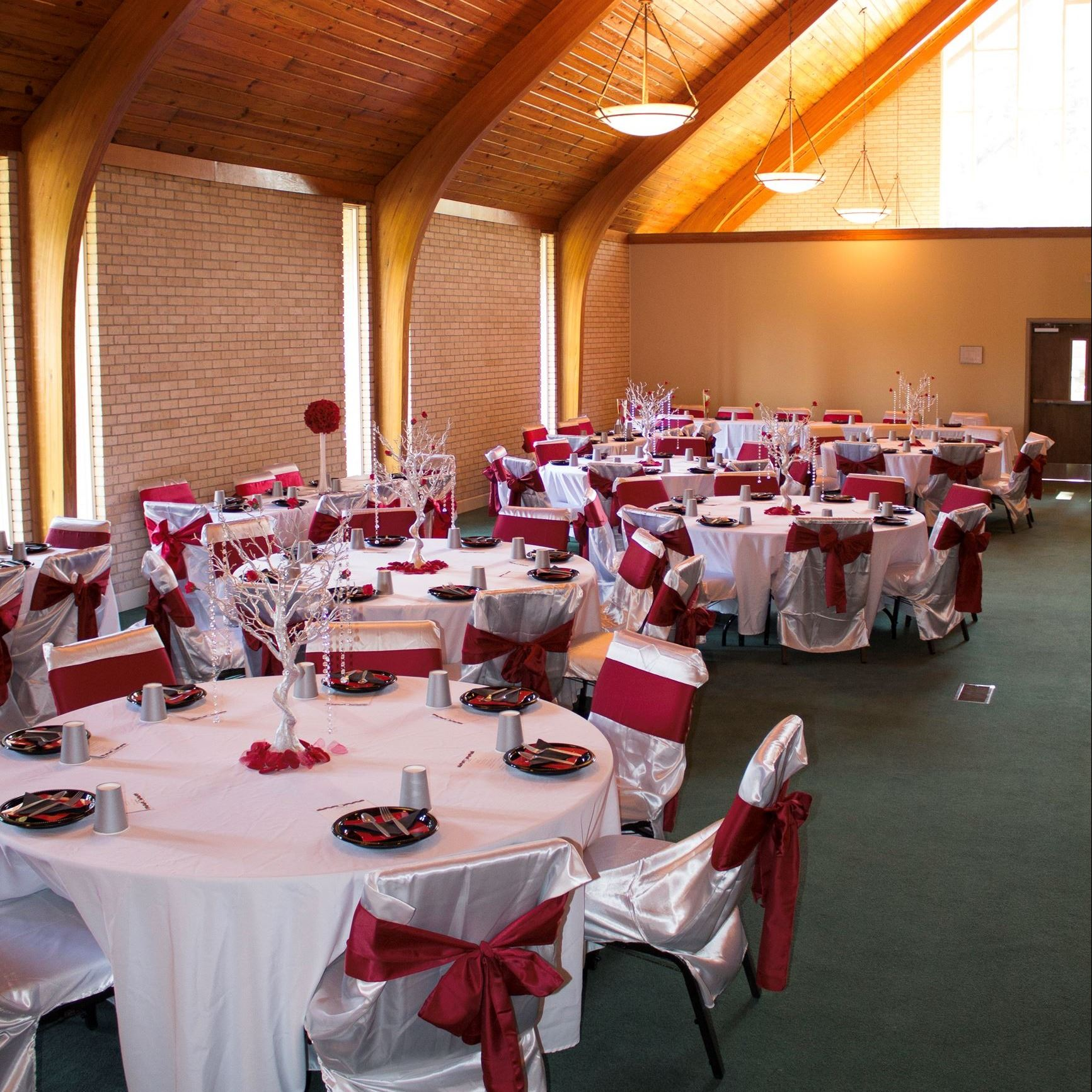 An image of a church sanctuary decorated for a wedding reception.