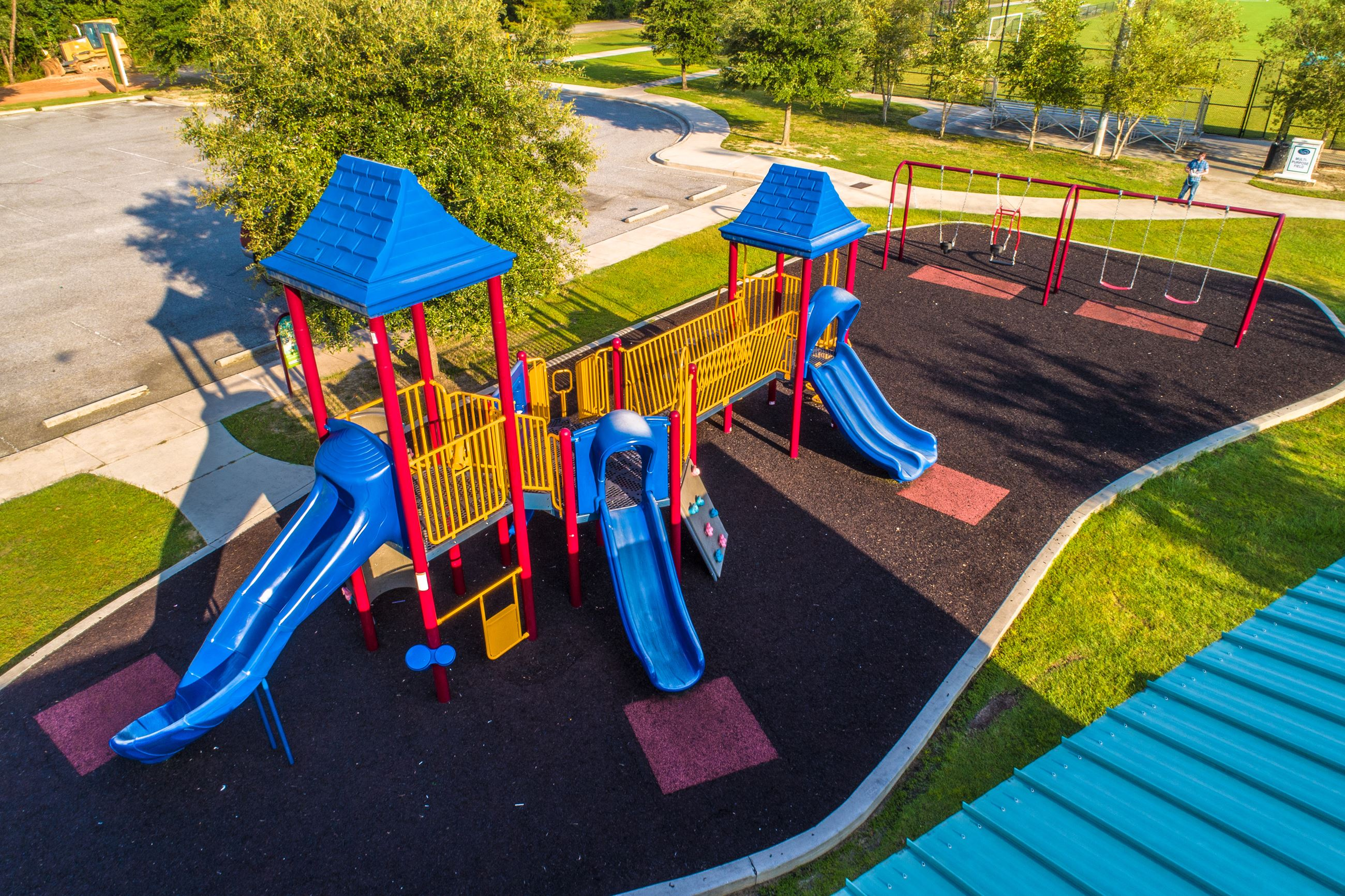 An image of an aerial view of a brightly colored playground.
