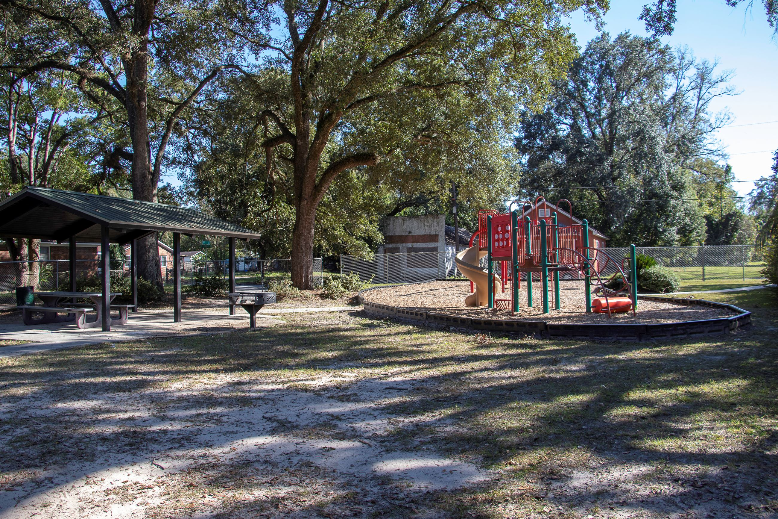 An image of a picnic shelter next to a playground.