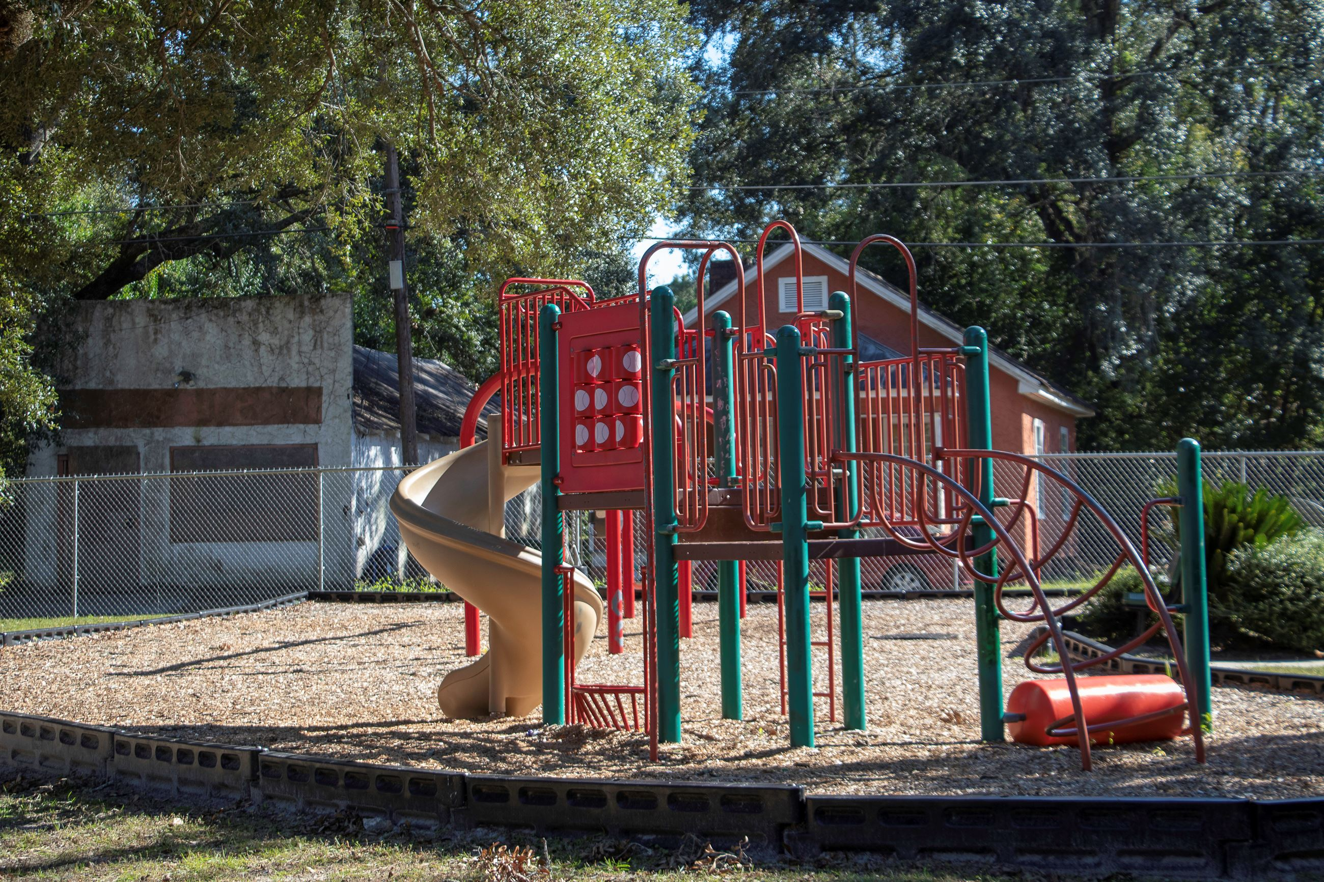 An image of a brightly colored playground in a park.