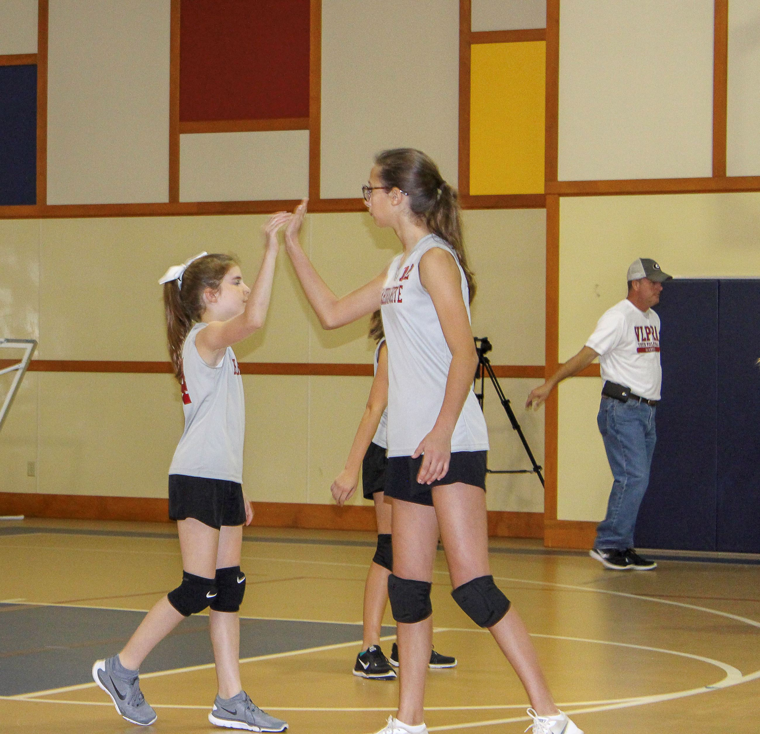 Image of girls playing volleyball.