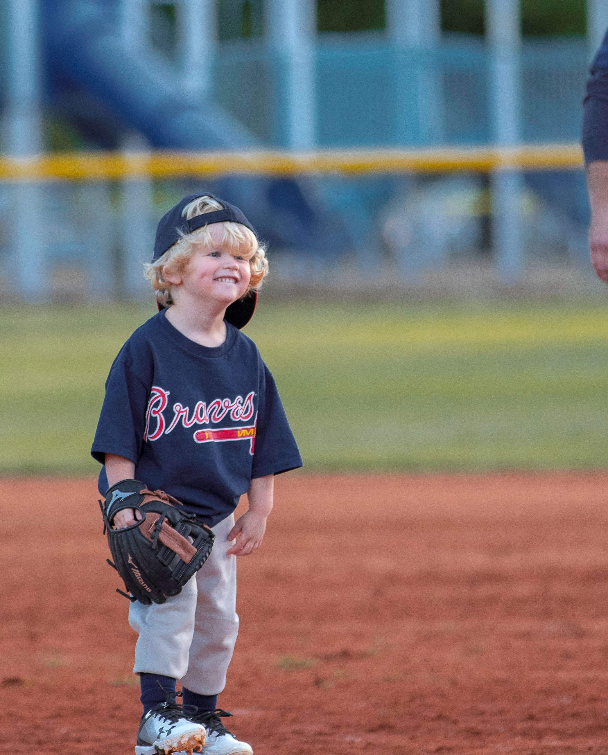 Image of little boy with baseball glove.