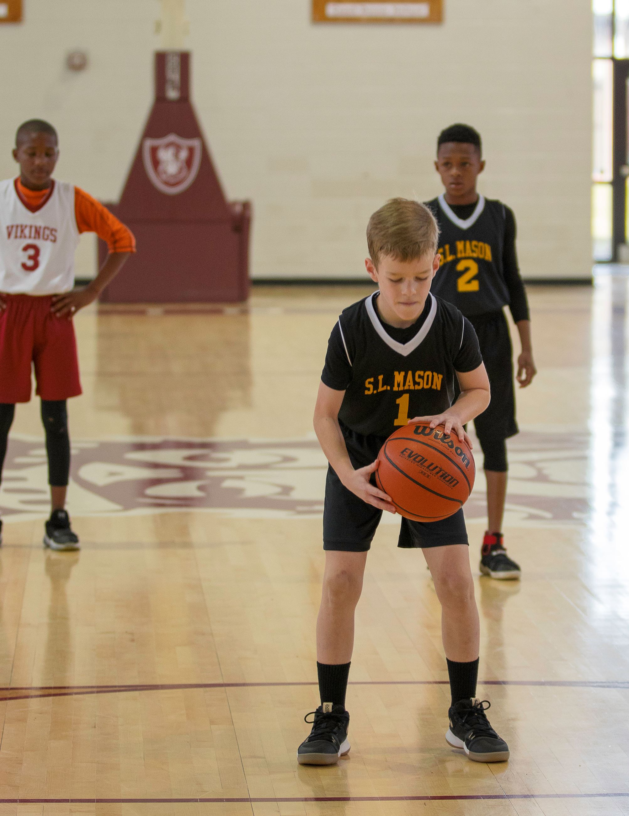 Image of boy playing basketball.