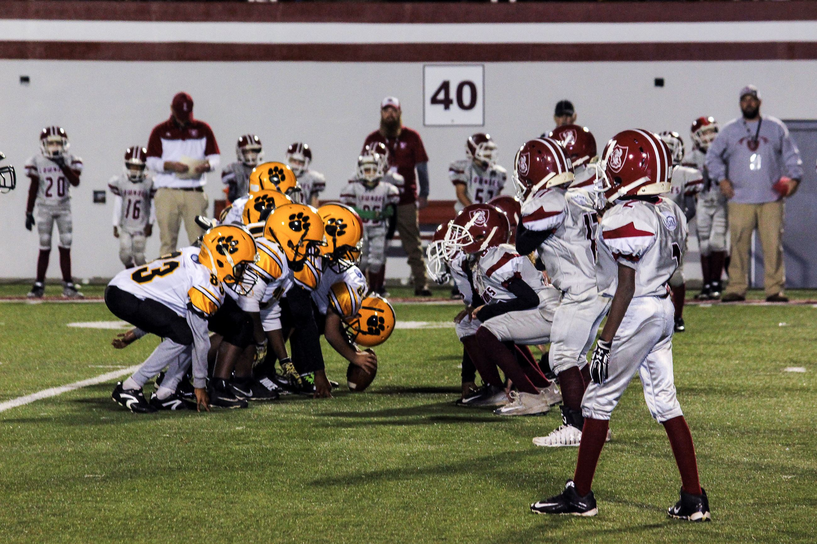 Image of football players on the line of scrimmage.