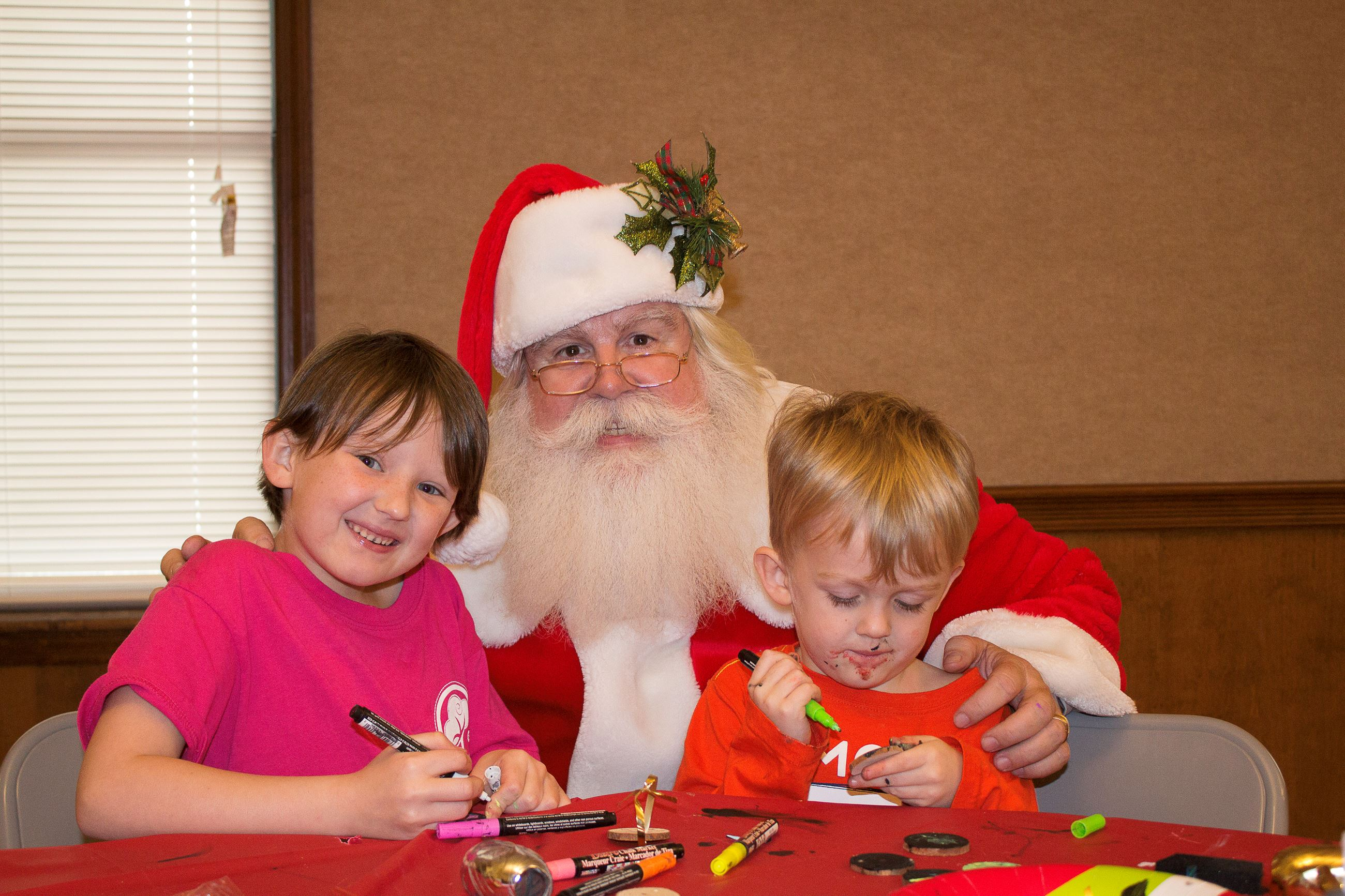 Image of two kids with Santa Claus.